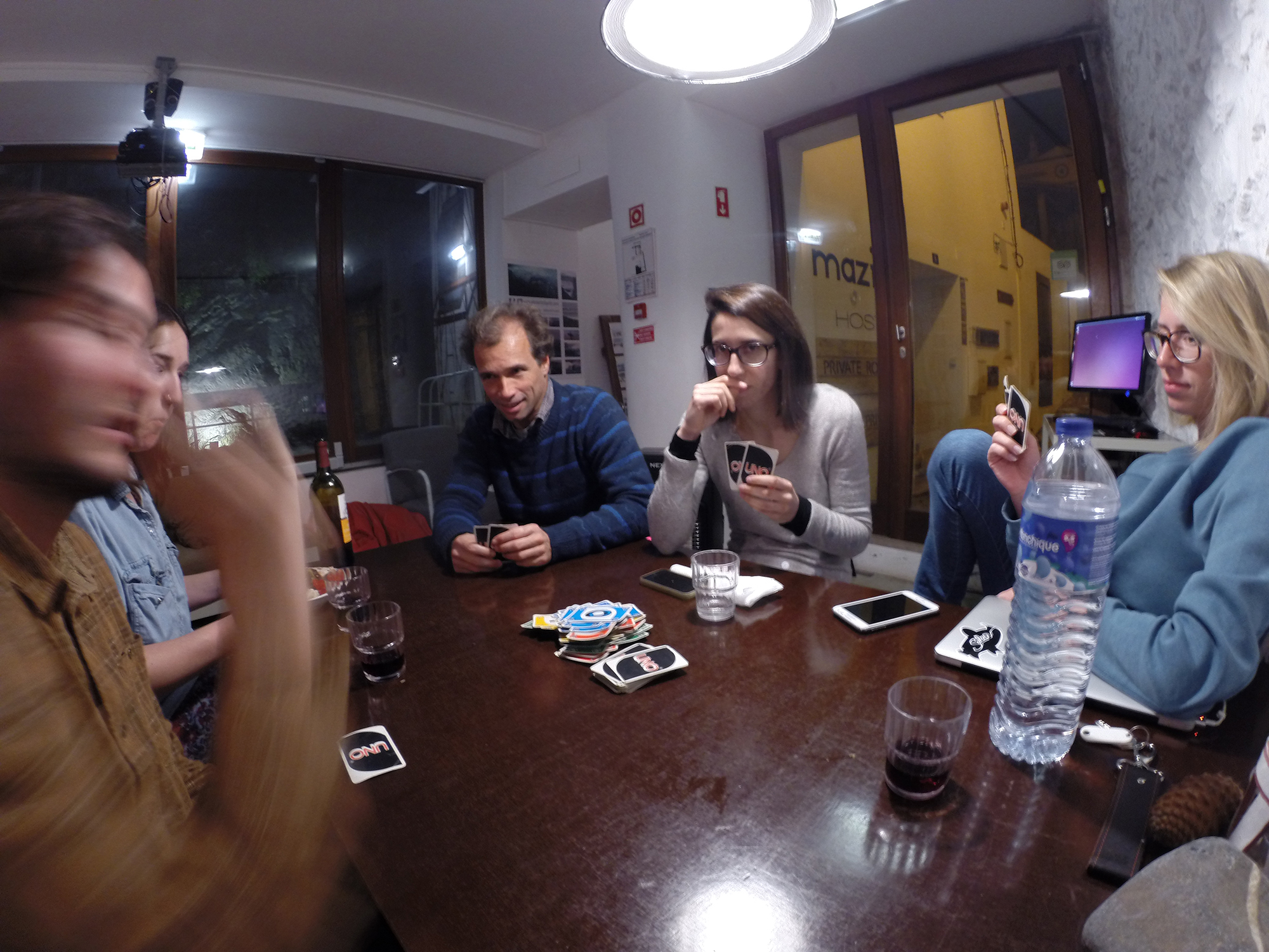 Playing Uno at Amazigh Hostel in Aljezur, Portugal