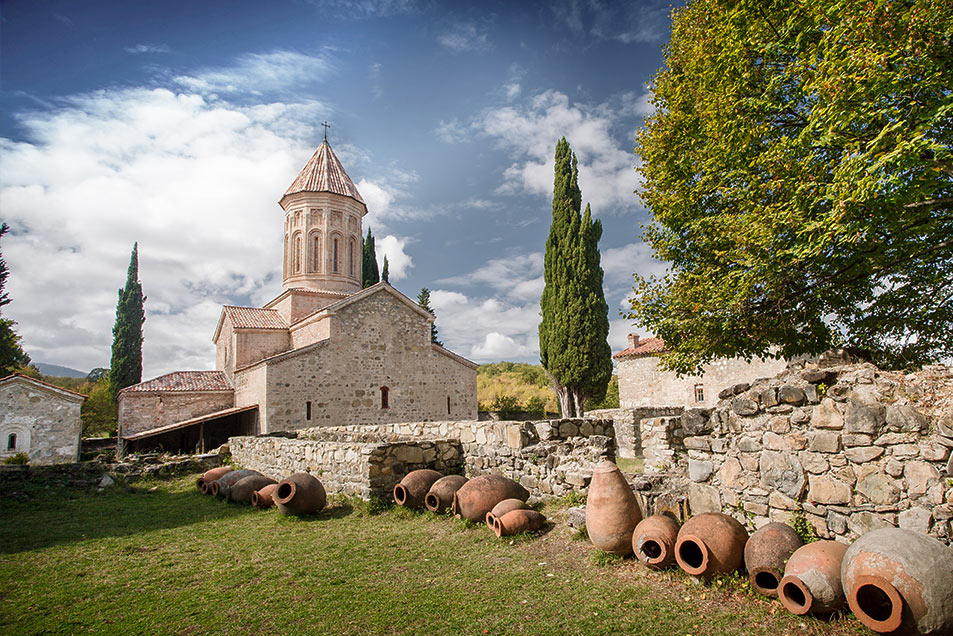 Traditional clay pots for making Georgian wine line this stone wall